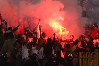 Algerians attack Egyptian firms after football loss thumbnail