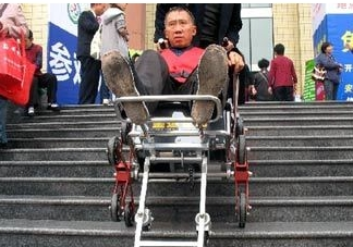 Chinese Man builds stair-climbing wheelchair thumbnail