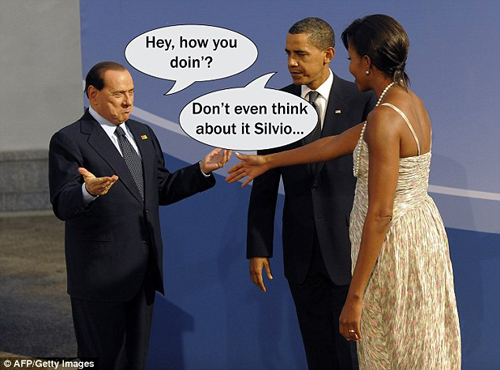 How YOU doin'? Obama doesn't look too happy as 'sex-addict' Berlusconi eyes up First Lady Michelle thumbnail